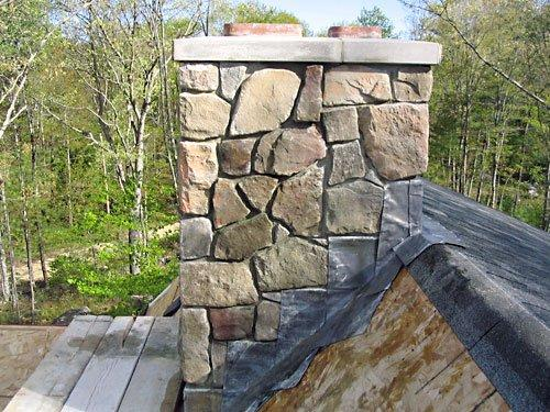 Cultured stone chimney with lead flashing.