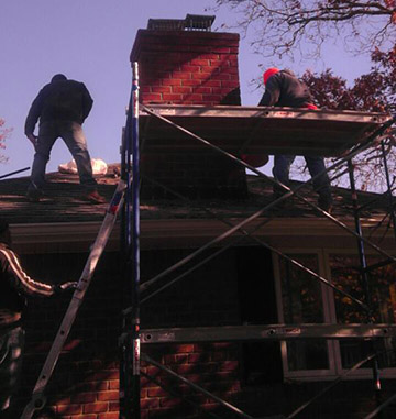 Rebuilding a chimney in Massapequa Park to match the rest of the house's brick venering.