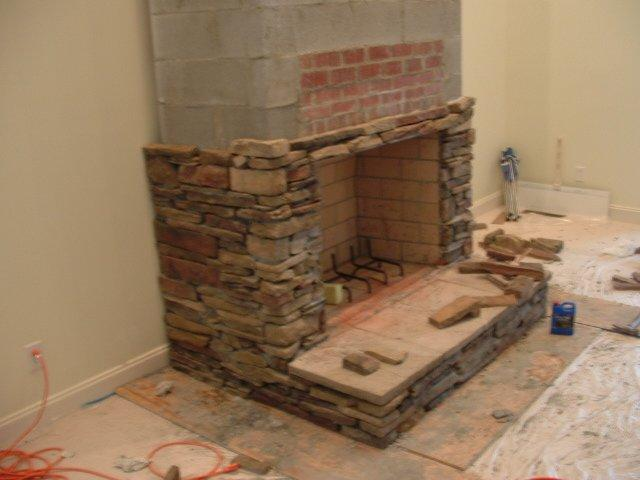 Modernized a standard brick fire place with culture stone.