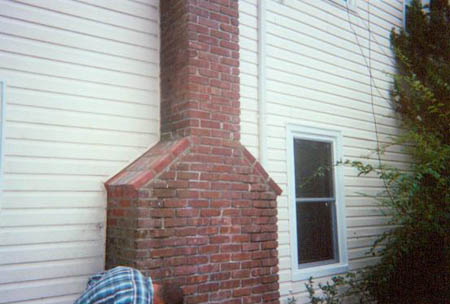 Repaired smoke shelf on a fireplace chimney.